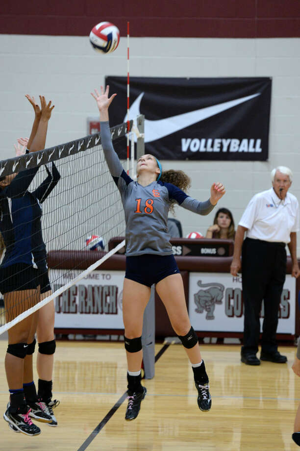 Seven Lakes' Camille Conner tips a ball at the net during the first round of the Nike Volleyball Classic, Aug. 14 at Cinco Ranch High School. The Lady Spartans won all three matches. Photo: Staff Photo By Craig Moseley