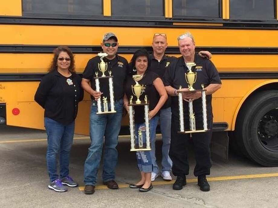 Pictured (from left to right): The Pasadena ISD Transportation Department dominated in the Road-e-o bus safety competition this year. Pictured: Diane Martinez, Joe Barrow, third place winner, Maria Rodriguez, first place winner, Francisco Mesa and second place winner Edward Fitzgerald. ~ Photo courtesy of Judy Wood.