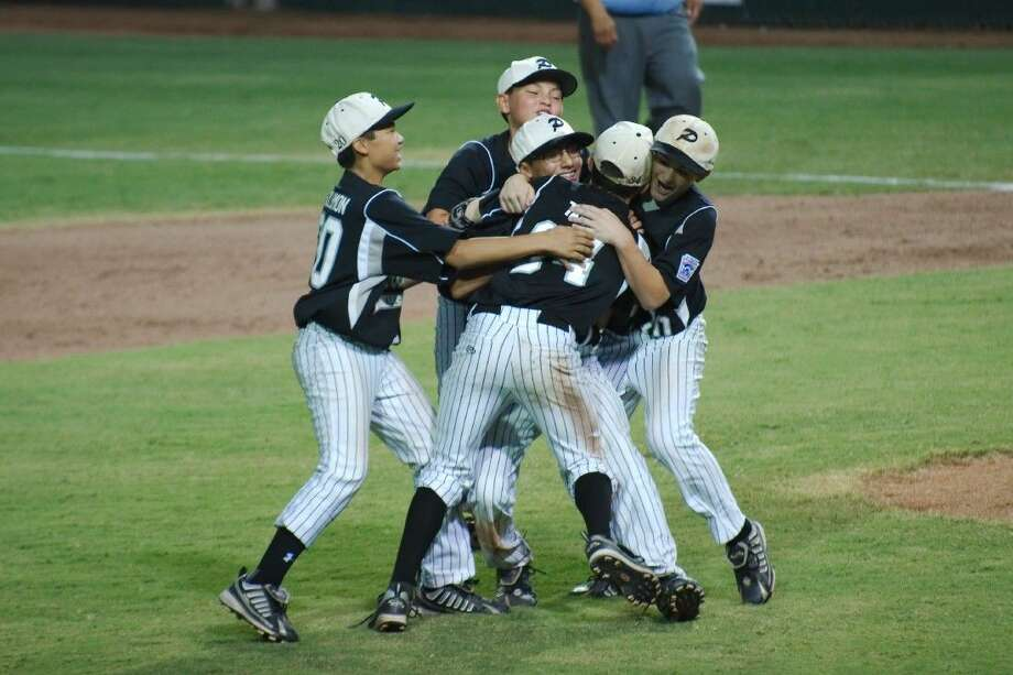 Pearland West Little League players Jarrett Tadlock (34), Zack Mack (24) and Caleb Low (10) swarm Isaac Garcia (17) after defeating North Boulder, Colorado in the Southwest Regional Championship game in Waco Thursday, Aug. 13.