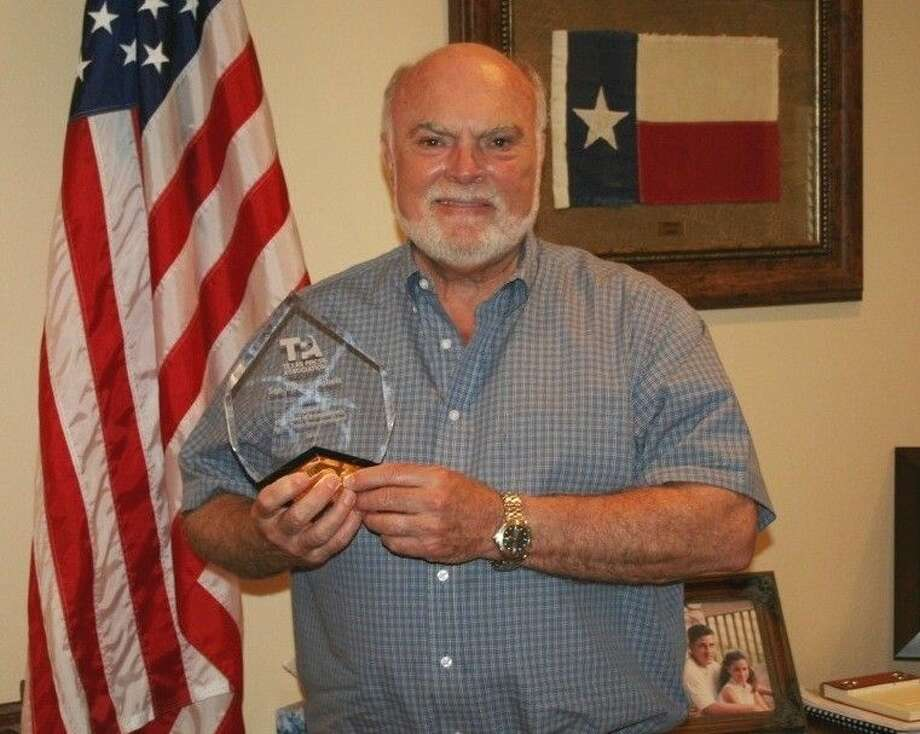 Senator Robert Nichols (R-Jacksonville) holds an award for Champion of Transparency from the Texas Press Association. Photo: Submitted