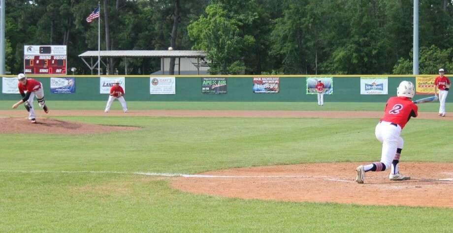 Weston Smith (1) of the Cleveland Indians tosses a fastball to Huffman Falcons batter Blake Boss (2). Photo: Jacob McAdams