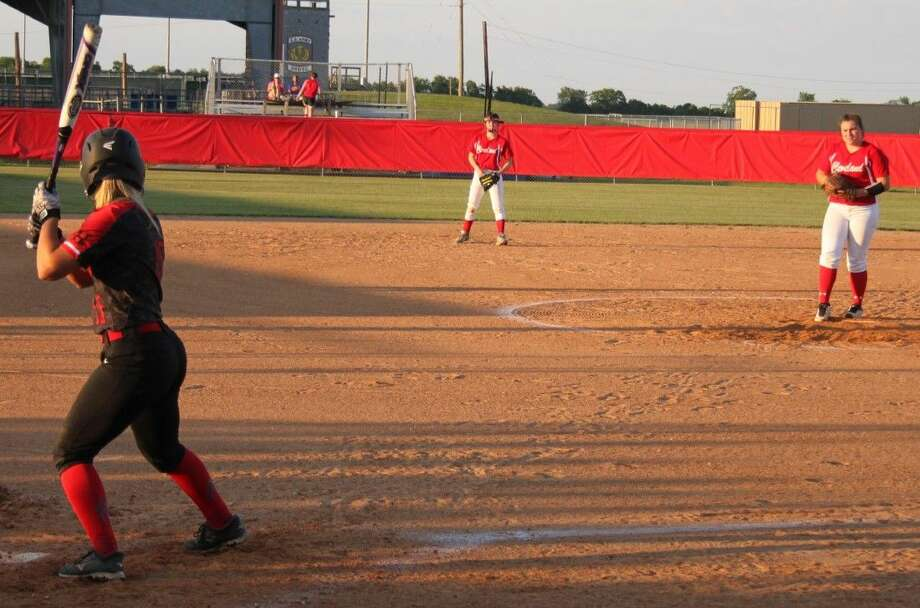 Ashley May (right) of the Lady Indians prepares to throw her next pitch against Lady Falcon Madi O'Neal (15). Photo: Jacob McAdams