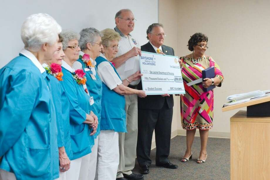 San Jacinto College Vice Chairman Larry Wilson and San Jacinto College Associate Degree Nursing Department Chair Dr. Veronica Jammer accept a $50,000 donation check from Bayshore Medical Center Volunteer Auxiliary Scholarship Committee Chairman John Logan Friday, Aug. 14.