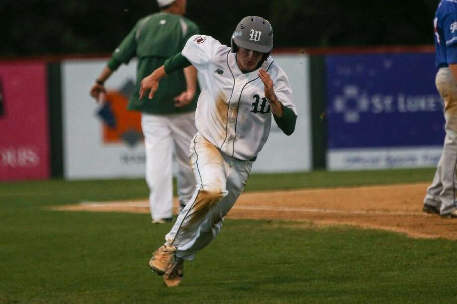 The Woodlands' Lex Trauffler (9) sprints for home plate this past Friday night against Oak Ridge.