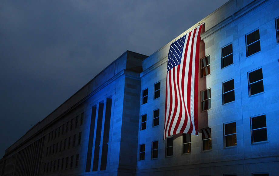 A memorial flag is illuminated near the spot where American Airlines Flight 77 crashed into the Pentagon on Sept. 11, 2001. (U.S. Navy photo/Pertty Officer 1st Class Brandan W. Schulze) Photo: MC1(SW) Brandan W. Schulze