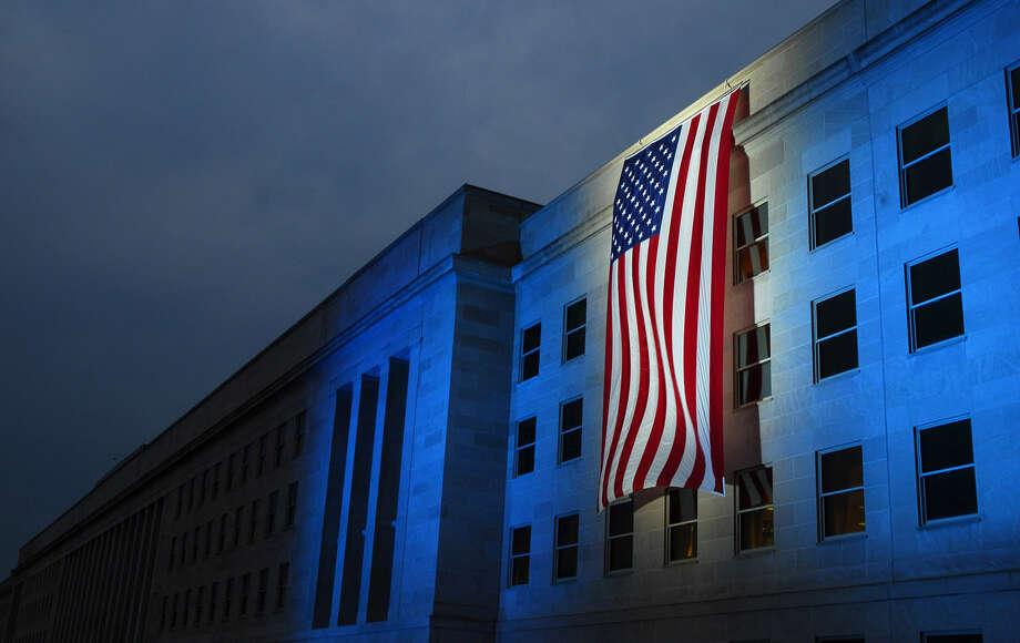 A memorial flag is illuminated near the spot where American Airlines Flight 77 crashed into the Pentagon on Sept. 11, 2001. (U.S. Navy photo/Pertty Officer 1st Class Brandan W. Schulze) Photo: MC1(SW) Brandan W. Schulze