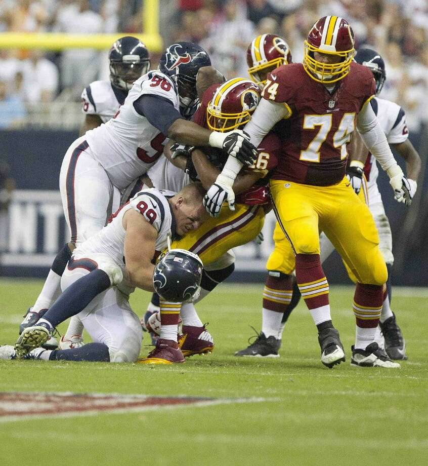 Staff photo by Jason FochtmanHouston Texans defensive end J.J. Watt made two tackles for losses, including a sack, blocked an extra point, recovered a fumble and batted down a pass in a 17-6 win over Washington on Sunday. Photo: Jason Fochtman