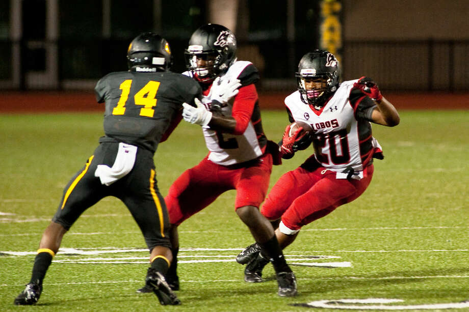 Tailback Christopher Williams (20) and receiver Quartney Davis (2) hope to help Langham Creek score a win over rival Cy Falls on Thursday. Photo: Tony Gaines/HCN