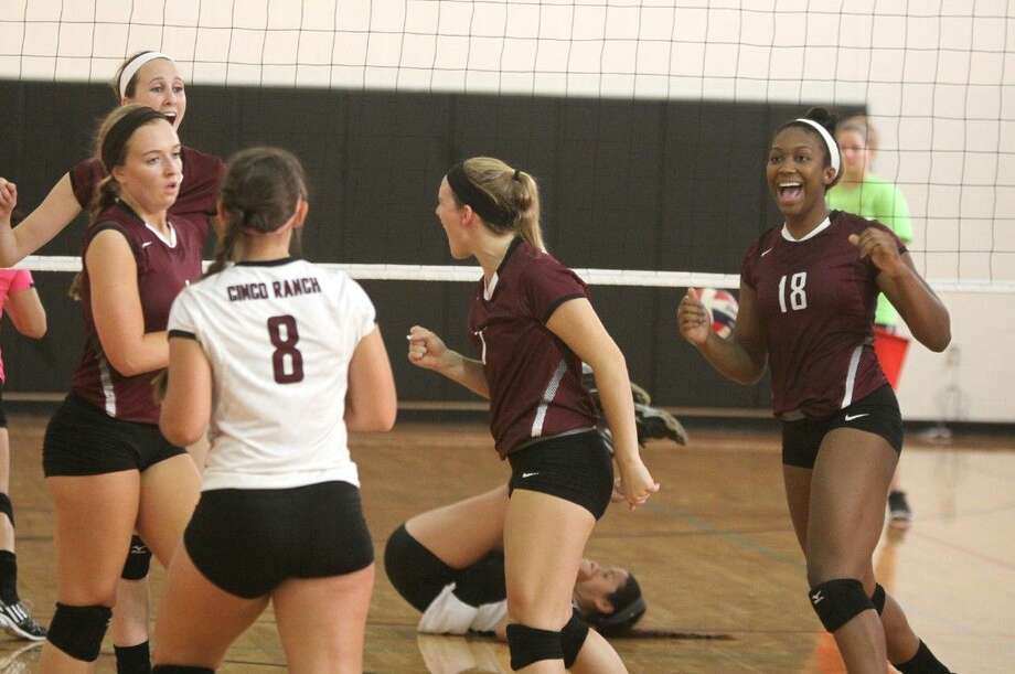 Photo by Alan WarrenCinco Ranch celebrates a point against Pearland during the Spring Branch ISD 2014 Varsity Tournament, Aug. 21 at Memorial High School in Houston. Photo: Alan Warren