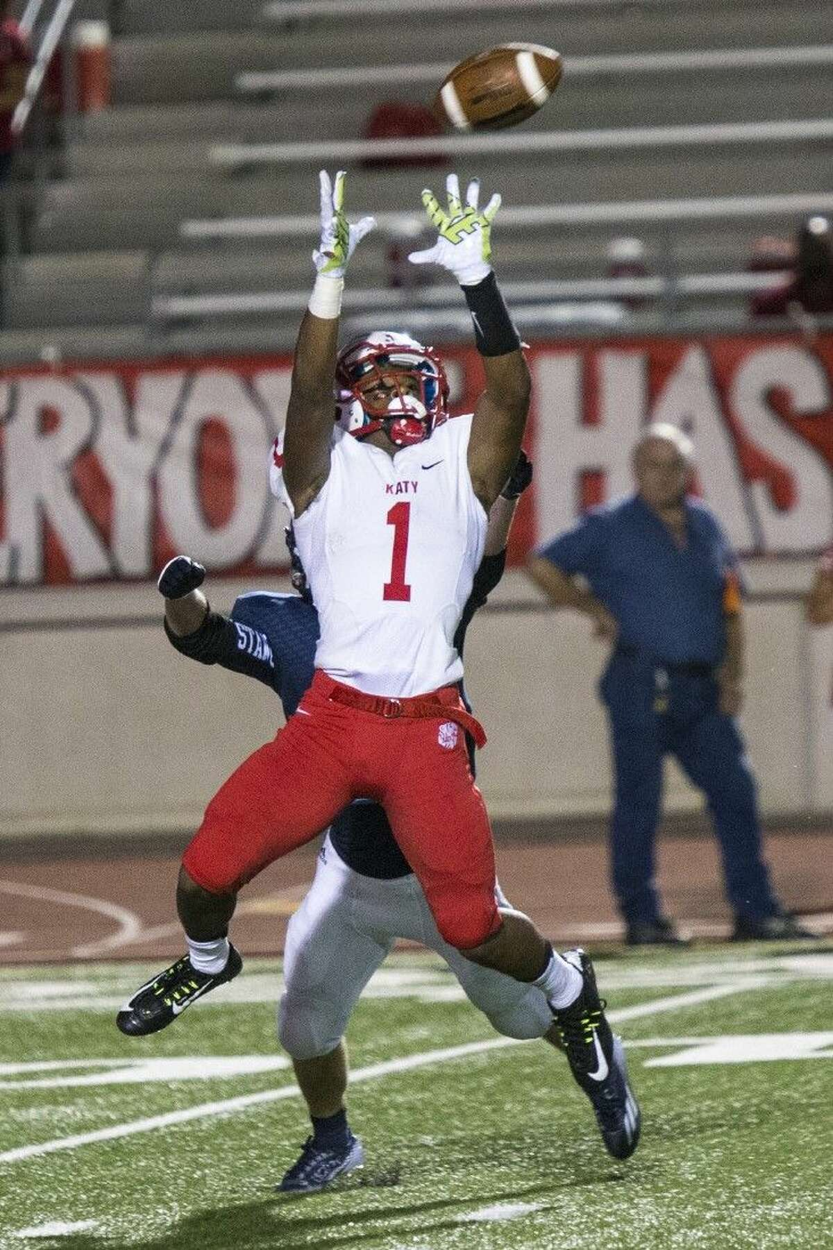 Staff photo by Andrew BuckleyKaty wide receiver Tony Mullins leaps to catch a pass during the Tigers' 31-0 win against Kingwood on Aug. 29 at Turner Stadium. Katy added a 55-0 shutout of Travis the following week.