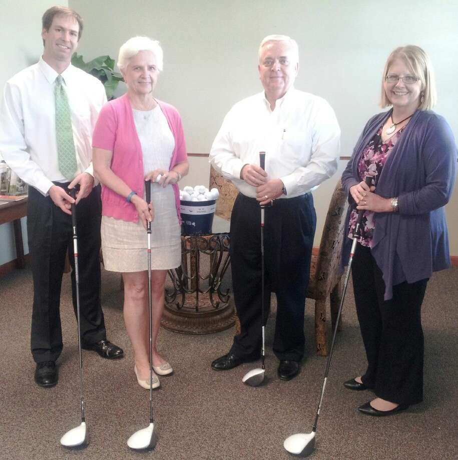 Tournament Chair Jacob Williamson and committee members Judy Van Cleve, Ed Slaback and Holly McDonald show off TaylorMade R15 drivers reserved for the winners of the 2015 Liberty Mutual Invitational on October 19.