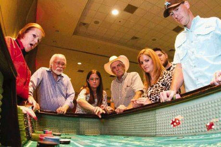 Montgomery County Fair Association members enjoy a night of food and casino games during the annual appreciation dinner Saturday.