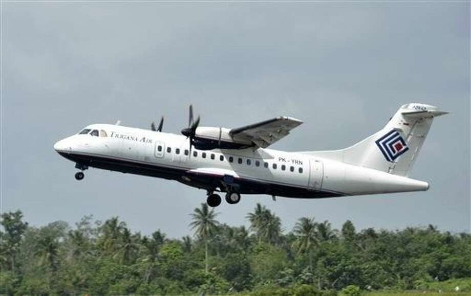The same type of a Trigana airliner carrying 54 people was missing Sunday after losing contact with ground control during a short flight in bad weather in the country's mountainous easternmost province of Papua, officials said. Photo: STR