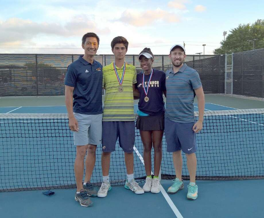 Cypress Ranch High School's mixed doubles tennis team won the Region III championship on April 21 in Deer Park to advance to the UIL Tennis State Tournament, May 16-17 at Texas A&M University. Pictured (L-R) are Minh Phan, head coach; Dylan Payne, sophomore; Melissa LaMette, freshman; and Jack Davidson, assistant coach. Photo: CFISD Communications