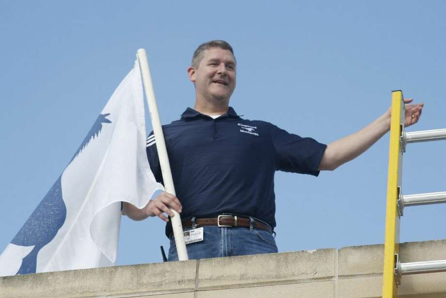 Staff photo by Jennifer Summer Kingwood High School Principal Ted Landry waves to students from the roof of Kingwood High School on Thursday, Sept. 11, 2014. Landry will spend 24 hours on the roof in order to raise $30,000 for the school's annual fund.