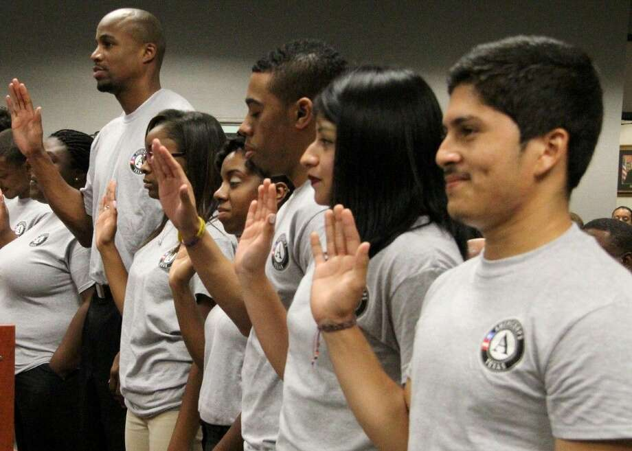 Photo by /AmeriCorps members from the Center for Afterschool, Summer and Expanded Learning, or CASE for Kids, are inducted at Harris County Department of Education during a May 2014 board of trustees meeting. Members work in after-school programs with students and are engaged in community service projects in greater Houston. For more information about opportunities, go to www.afterschoolzone.org .