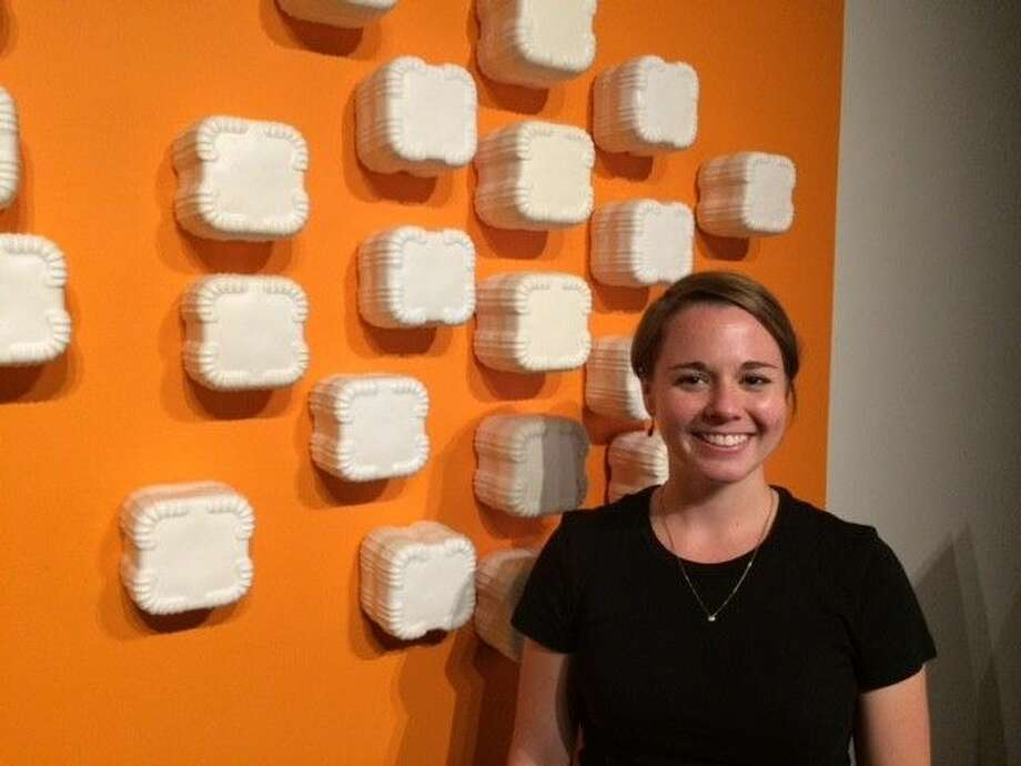 "Natasha Hovey, ceramic artist, poses in front of her piece called ""Positioning"". Her exhibit ""One of Two or More"" is on display until September 10 at the Houston Community College West Loop Campus Gallery, which is free and open to the public M-F."