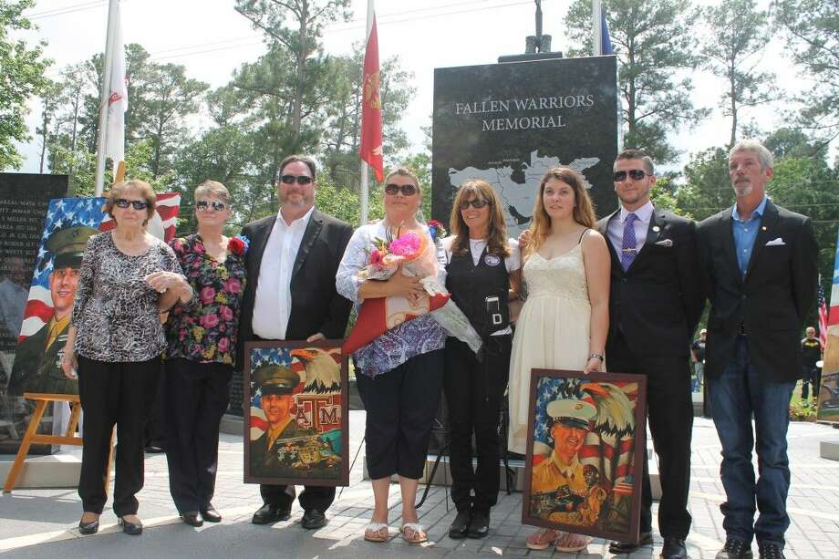 National Memorial Ladies President Cheryl Whitfield stands with the families of Major Shawn Campbell and Corporal Matthew Drown. Photo: Taelor Smith