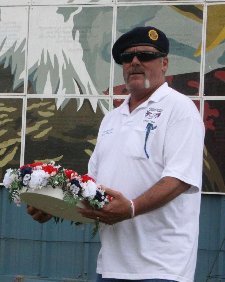 Staff photo by Jacob McAdamsAmerican Legion Post 629 Commander Chuck Baxley presents a wreath in remembrance of the tragedy of the Sept. 11 attacks and all of those who lost their lives. Photo: Staff Photo By Jacob McAdams