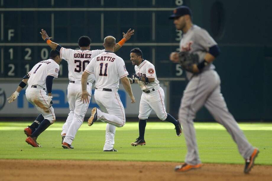 The Astros' Jose Altuve, right, n Astros, celebrates after hitting the game-winning single to score Jake Marisnick in the bottom of the ninth inning against the Detroit Tigers at Minute Maid Park Sunday. The Houston Astros defeated the Detroit Tigers 6-5.