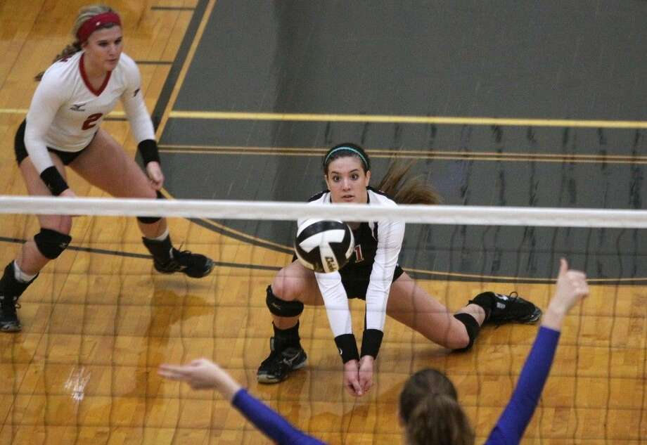 Paige Swinney (11), Julia Whitehead (2) and Austin won eight of nine matches and reached the Gold Bracket at the Texas Volleyball Invitational in Pearland. Photo: HCN File Photo