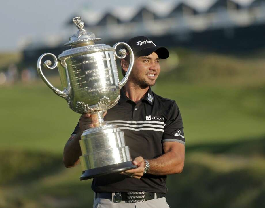 Australia's Jason Day holds up the Wanamaker Trophy after winning the PGA Championship at Whistling Straits in Sheybogan, Wisconsin. Day closed with a 5-under 67 on Sunday.