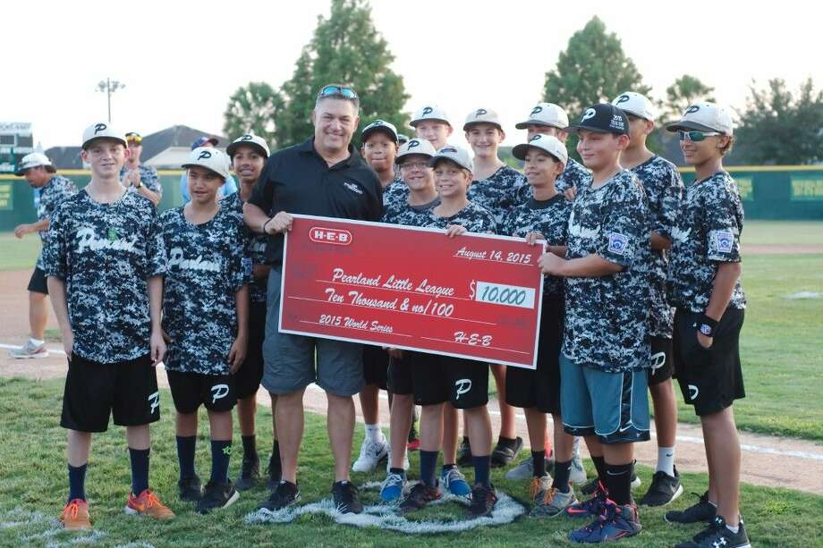 Pearland West Little League players stand with Pearland Parkway HEB Unit Director Jim Doxakis Friday (Aug. 14) as HEB donates $10,000 during a fundraising event to send the team to the World Series in Williamsport, Penn.