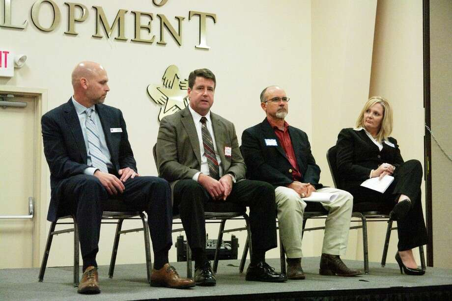 Staff photo by Matthew CostaFrom left to right, Willis ISD Superintendent Tim Harkrider, Kongsberg Automotive Executive Vice President Jim Ryan, Owner of American Civil Engineering Services Brent Sherrod, and Deputy Director of the Greater Conroe Economic Development Council Danielle Scheiner speak during the Willis Economic Summit panel discussion