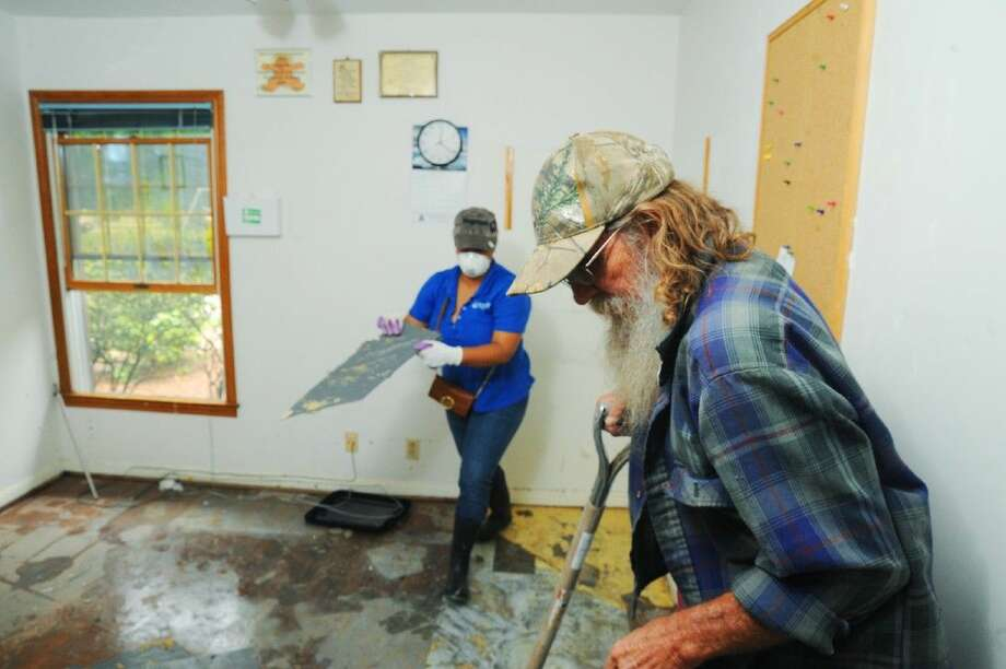 Volunteers help clean up debris at one of the Bethesda Lutheran Communities location in Cypress on Thursday, April 21.