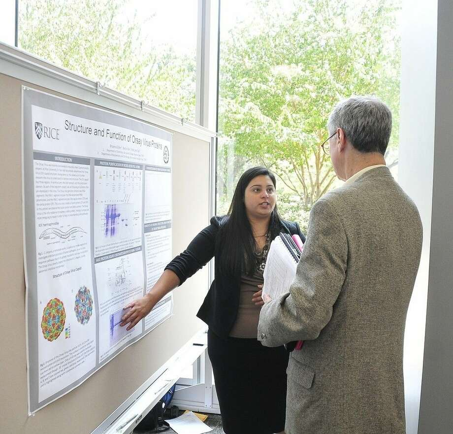 Brianna Siller presents her research on the Orsay virus at the Rice University Summer Undergraduate Research Program poster symposium. She and Norma Perez, both San Jacinto College students, were selected for the 10-week program. Photo credit: Jeannie Peng-Armao, San Jacinto College marketing, public relations, and government affairs department.