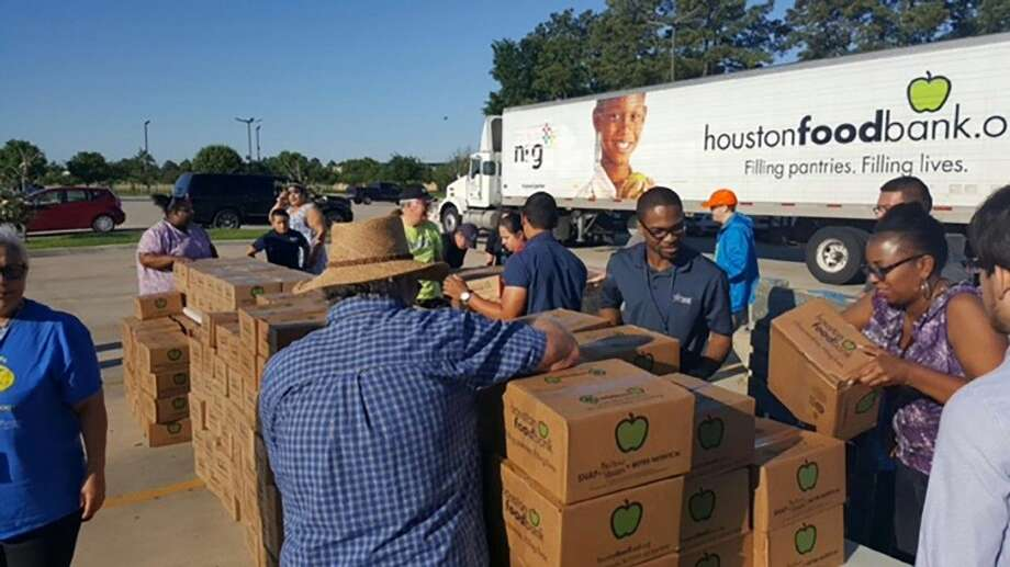 Lone Star College is helping victims of the recent floods. Pictured are LSC-North Harris students and staff distributing water and disaster relief boxes in partnership with Communities in Schools and Houston Food Bank. Photo: Submitted Photo