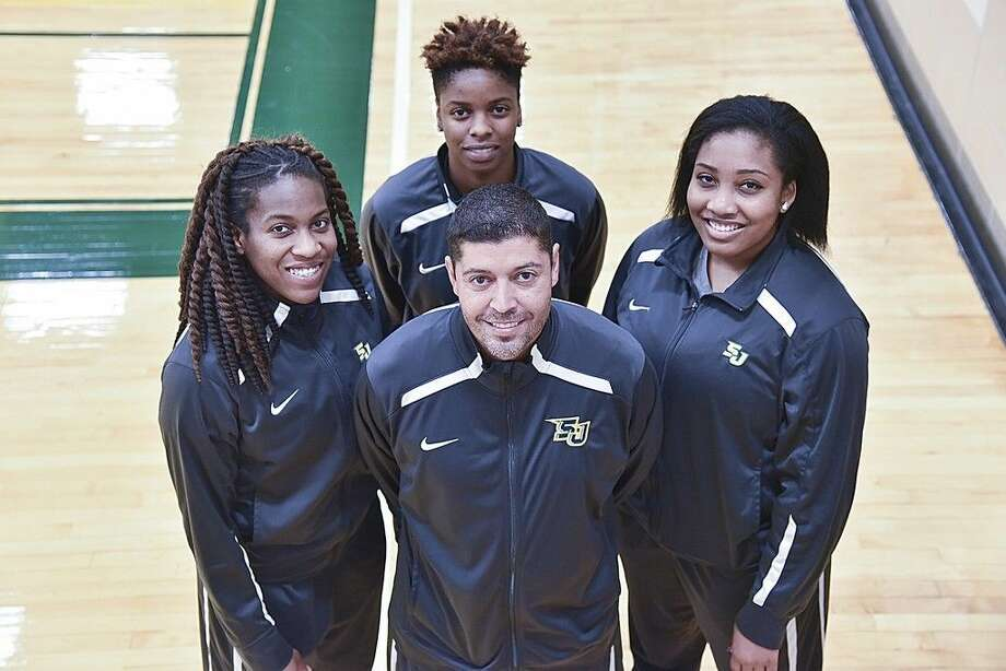 Kristel Reid (left), Kaelynn Wilson (center), and Vanessa Jones (right) have been recognized by the National Junior College Athletic Association (NJCAA) Region XI for their outstanding play during the 2015-2016 season. Pictured with the student-athletes is San Jacinto College Women's Basketball Head Coach Michael Madrid. Photo credit: Rob Vanya, San Jacinto College marketing, public relations, and government affairs department.