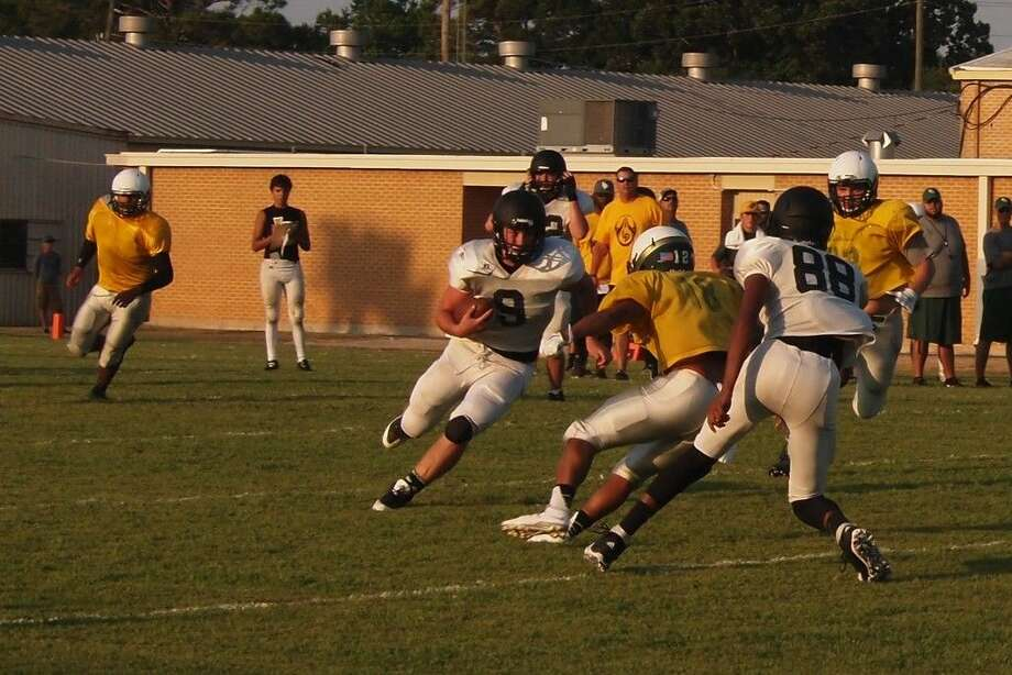 Reid Williams cuts left on a carry for Liberty in their scrimmage against East Chambers on Friday, Aug. 14, 2015. Photo: Casey Stinnett