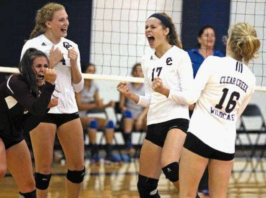 Clear Creek players Olivia Rigby (6), Jenna Metzinger (24), Alle Garland (17) and Kelsey Childers (16) celebrate after a point against Veterans Memorial during the Adidas Invitational in Pearland. Photo: Kar B Hlava
