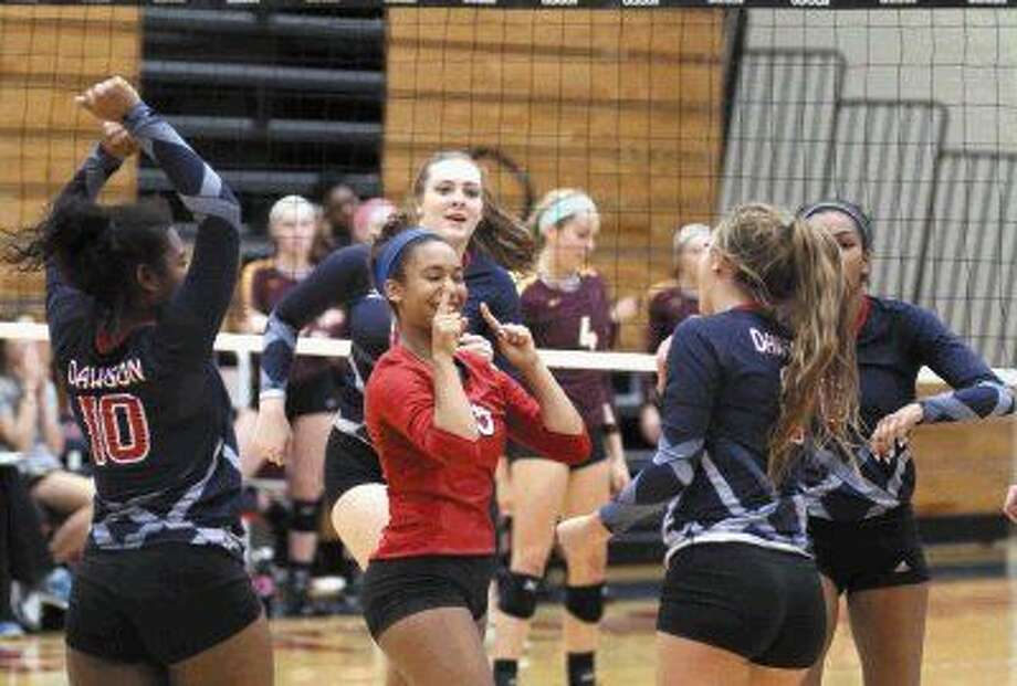 Dawson's Jordan Brown celebrates with teammates after a point against Deer Park during the Adidas Invitational. Photo: Kar B Hlava