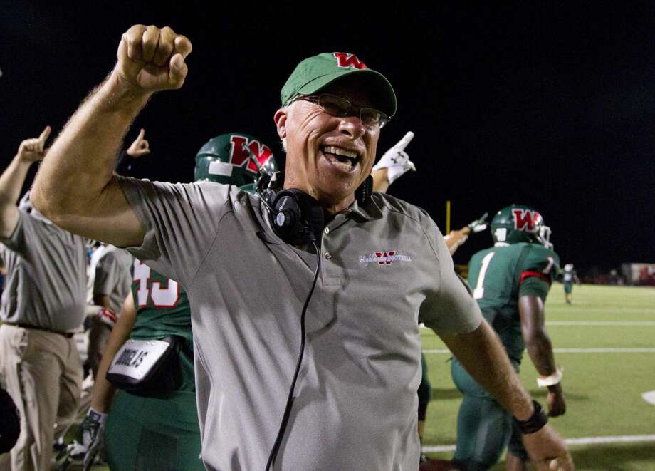 The Woodlands coach Mark Schmid celebrates after defeating Katy 24-7 to break the Tigers' 50-game regular-season winning streak during a high school football game at Woodforest Bank Stadium Friday. To view or purchase this photo and others like it, visit HCNpics.com. Photo: Jason Fochtman