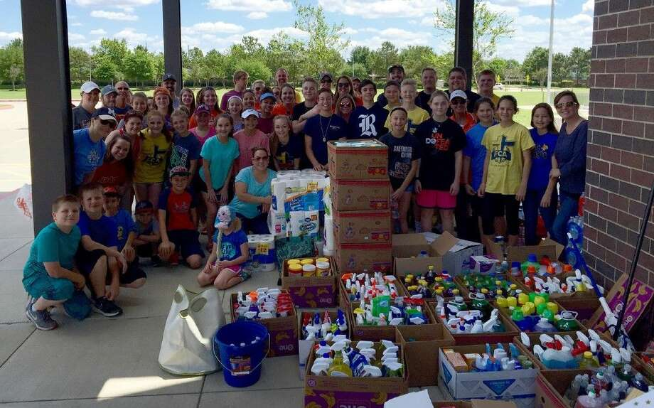 Salyards Middle School students and staff hold a flood relief donation drive on April 22 that raised more than 5,200 in gift cards and eight truckloads of cleaning supplies for Cy-Hope.