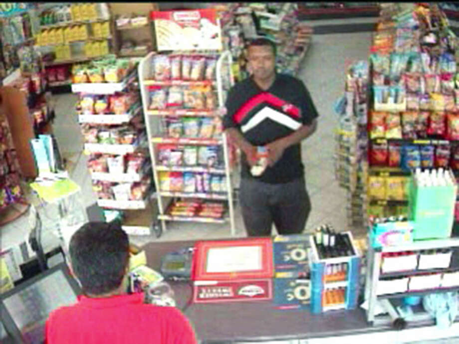 An image from surveillance footage of one of the two suspects wanted in connection with the robbery of a cell phone outlet on Highway 6 in late July. Photo: Image Courtesy Fort Bend County Crimes Stoppers