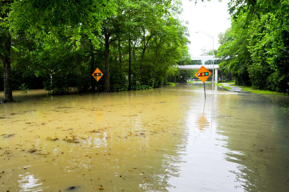 The entrance to the Hewlitt Packard campus, home to Lone Star College-University Park, remains flooded. The college system has announced it will not hold classes on Wednesday. Photo: Tony Gaines