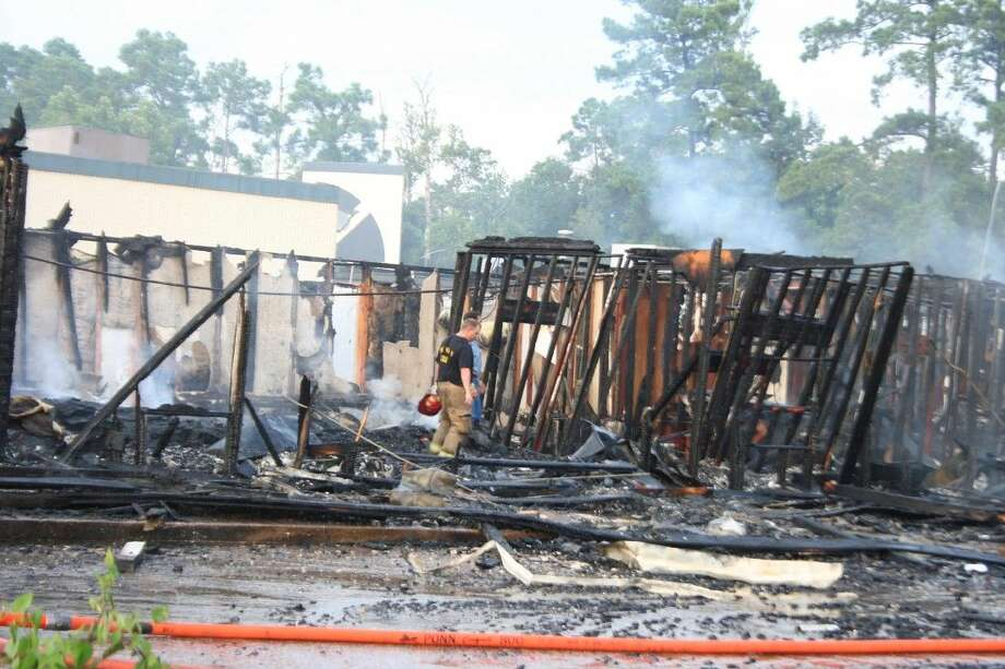 Houston Fire Department firefighters responded to a two-alarm fire at the business located on Loop 494 at the front of Kingwood called A Hair Place Monday, Aug. 17, 2015.