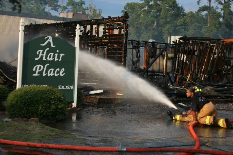 A Hair Place was damaged by a two-alarm fire that ripped through the building Monday, Aug. 17, 2015.