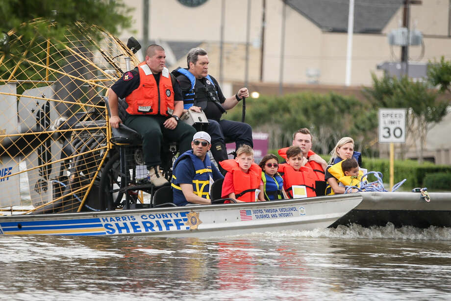 Emergency services evacuate residents from a flooded subdivision on Tuesday, April 19, 2016, at Cypresswood Drive and Spring Stuebner Road. Photo: Michael Minasi