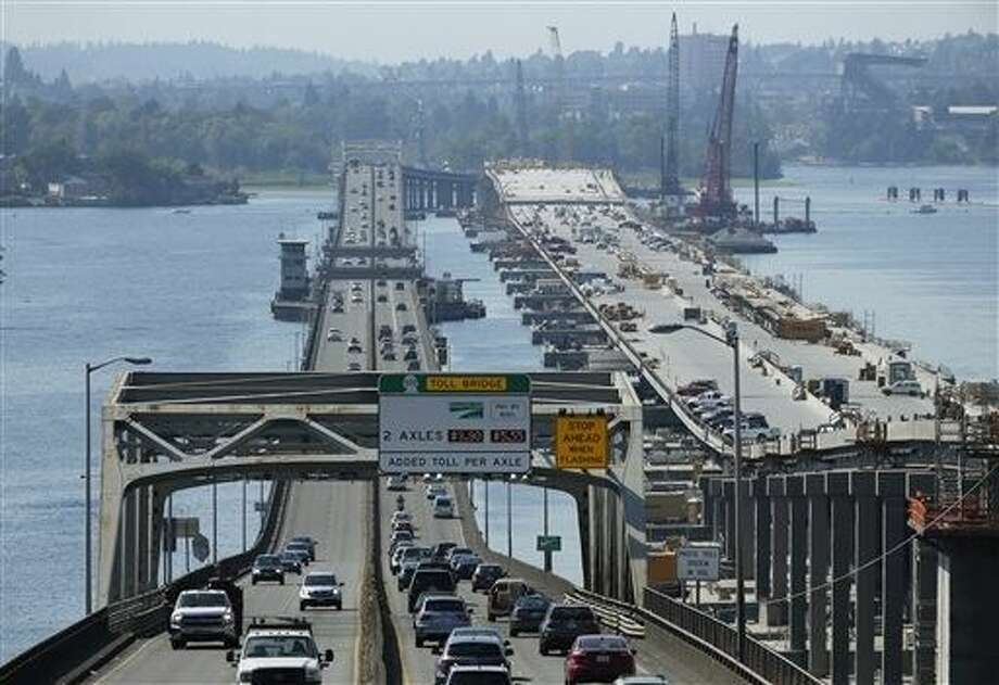 Washington state recently approved a 16-year, 16 billion transportation plan that raises fuel taxes, vehicle fees and bonding to pay for finishing the construction of the bridge and other projects intended to reduce traffic congestion and repair crumbling infrastructure in the state. Photo: Ted S. Warren