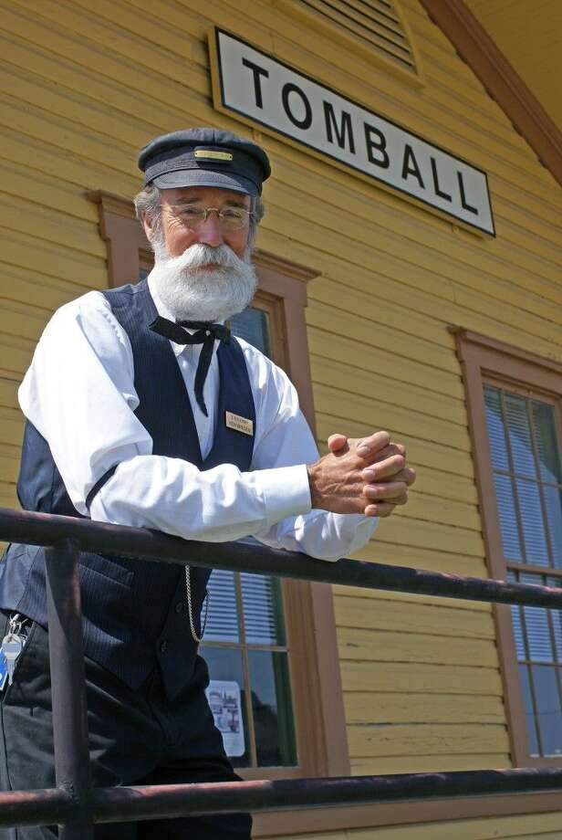 The sculpture will depict Tomball Depot Station Agent Ken Walden standing in this iconic pose outside the historic downtown depot. Photo: Submitted