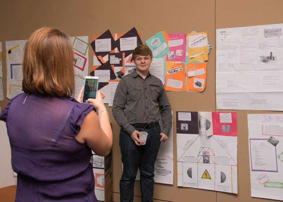 Klein Collins High School senior Ethan Collins poses for a snapshot by the career presentations made by Project GRAD students during a two-week institute at Lone Star College-University Park. Photo: Submitted Photo