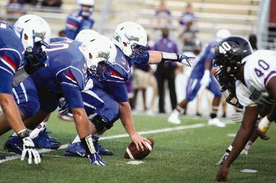 Oak Ridge's offensive line faces off against the Morton Ranch defense on Saturday, Aug. 30, at Woodforest Bank Stadium. To view or purchase this photo and others like it, visit HCNpics.com.