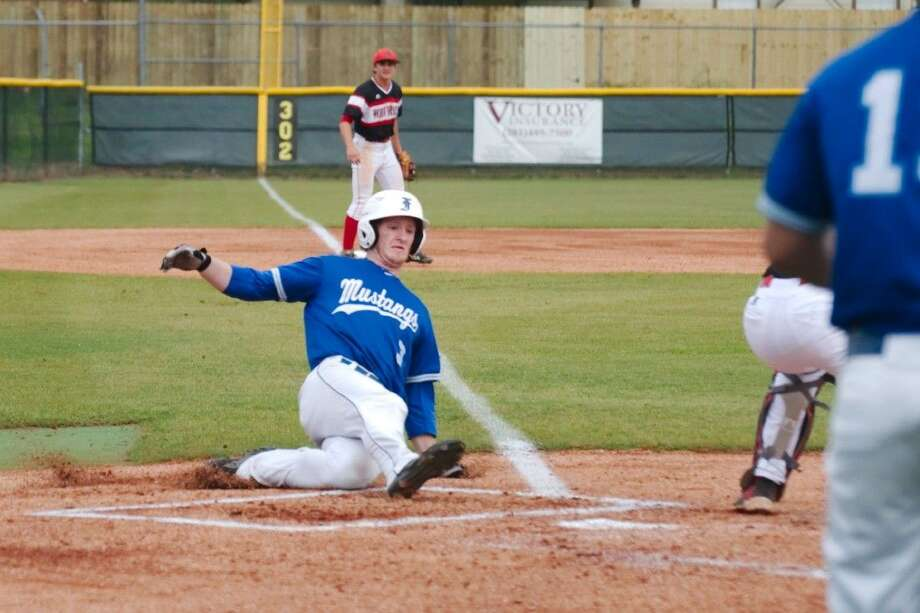 Friendswood's Ryan Bertelsman (3) slides safely into home plate against Clear Brook Tuesday night. Photo: Kirk Sides