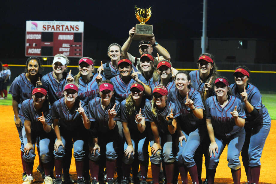 The Cypress Woods Lady Wildcats celebrate their district championship after an 8-1 win at Cypress Lakes Tuesday, April 26, 2016. With the victory, the Lady Wildcats secured not only the district title, but also a perfect 17-0 district season. Photo: Tony Gaines