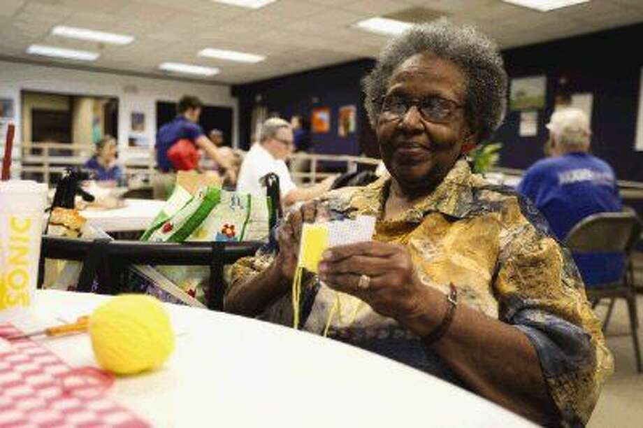 Photo by Michael MinasiAlice Smith knits a design on Wednesday at the Friendship Center in Conroe.
