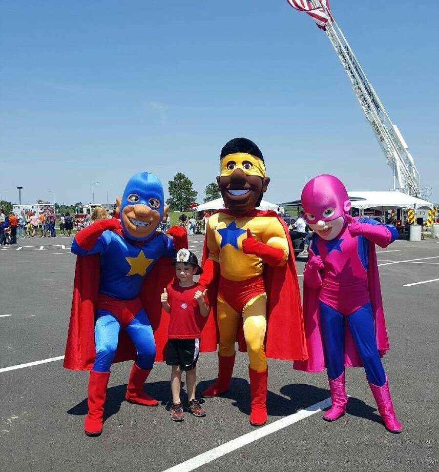 The Ready Heroes with the Disaster Preparedness program pose for a photo during ESD 48's Safety Fest this past Saturday. ESD 48's inaugural event offered upbeat ways for families to learn about safety and prevention.